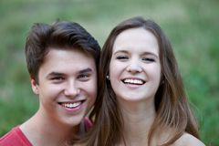 Happy laughing young teenage couple Royalty Free Stock Images