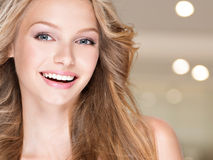 Happy laughing young woman with long hair Royalty Free Stock Photo