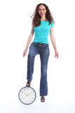 Happy laughing young woman standing on time clock Stock Image