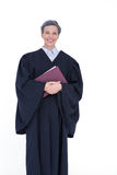 Happy lawyer looking at camera and holding law code Royalty Free Stock Photos