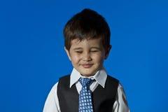 Happy Leader, cute little boy portrait over blue chroma backgrou. Businessman, cute little boy portrait over blue chroma background Stock Images