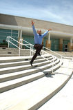 Happy Leap. Happy business man takes a leap off some buisness steps Royalty Free Stock Images
