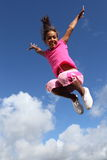 Happy leap of joy great success for young girl Royalty Free Stock Images