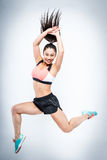Happy Leaping Jumping Workout Girl. Royalty Free Stock Photography