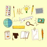 Happy learning doodle color set. Doodle color set about education and learning on paper background including  plane; ruler; pencil; notebook; planet; camera Royalty Free Stock Images