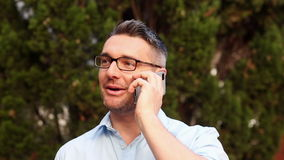 Happy lecturer answering his phone Stock Photos