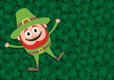 Happy Leprechaun on Clovers Royalty Free Stock Image