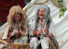 Happy leprous women. Nogent le Rotrou,France,May,16th,2010: Two actors women wearing a specific costume and make-up for leprous people in the medieval ages Royalty Free Stock Photos