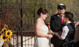 Happy Couple in Civil Union. Happy lesbian couple with rabbi in civil union ceremony Royalty Free Stock Photography