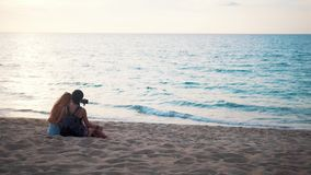 Happy lesbians taking selfie photo on the beach. Happy women enjoying vacation taking selfie photo stock video footage