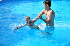 Happy lessons of swimming Royalty Free Stock Image