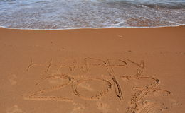 Happy 2017 lettering on the beach. Royalty Free Stock Photos