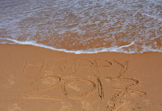 Happy 2017 lettering on the beach. Royalty Free Stock Photo
