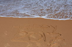 Happy 2017 lettering on the beach. Royalty Free Stock Images