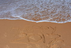 Happy 2017 lettering on the beach. Royalty Free Stock Photography