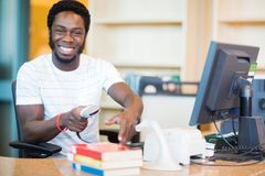 Happy Librarian Scanning Books In Library stock images
