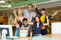 Happy library staff Stock Images