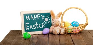 Painted Easter eggs in a basket on the table with royalty free stock images