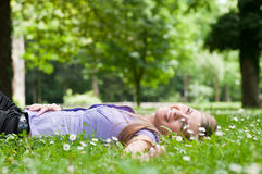 Happy life - lying in grass Stock Image