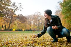 Happy life - woman throwing leaves in fall Royalty Free Stock Images