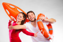 Happy lifeguard couple with equipment Stock Image