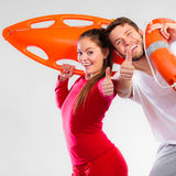 Happy lifeguard couple with equipment Stock Photos