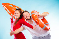 Happy lifeguard couple with equipment Royalty Free Stock Image