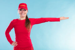 Happy lifeguard woman in cap pointing direction. Royalty Free Stock Image