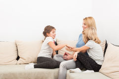Happy lifestyle concept with mother and young daughters Royalty Free Stock Photo