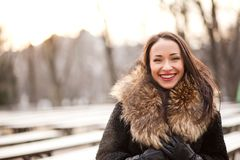 Happy lifestyle. Happy and healthy smiling woman during the winter in the park Royalty Free Stock Photos