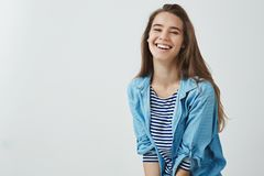Happy lifestyle, wellbeing concept. Charming carefree smiling attractive woman laughing out loud feeling lucky upbeat royalty free stock photography