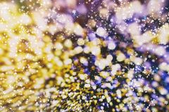 Happy lights to brighten up the dark days of winter, or bring fun to long summer nights. Blurred bokeh christmas background with snowflakes . Awesome winter royalty free stock image