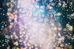 Happy lights to brighten up the dark days of winter, or bring fun to long summer nights. Blurred bokeh christmas background with snowflakes . Awesome winter stock photos