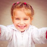 Happy liitle girl close-up Royalty Free Stock Photo