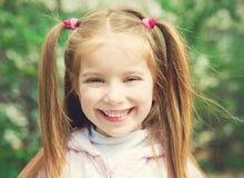 Happy liitle girl Stock Photos