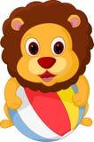 Happy lion cartoon playing ball Stock Image