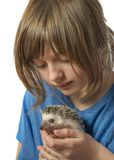 Happy litle girl with African pygmy hedgehog stock photography