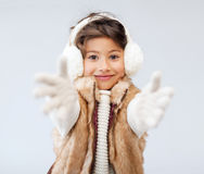 Happy littl girl in winter clothes Stock Image
