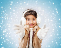 Happy littl girl in winter clothes Stock Images