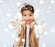 Happy littl girl in winter clothes Stock Photography