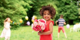Happy little african american girl with flowers royalty free stock images
