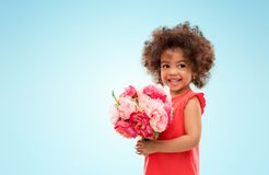 Happy little african american girl with flowers royalty free stock photo