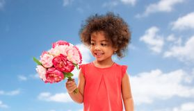 Happy little african american girl with flowers stock photography
