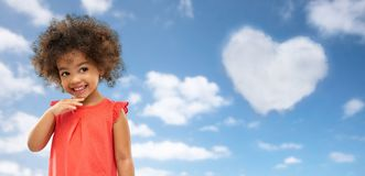 Happy little african american girl over blue sky royalty free stock photo