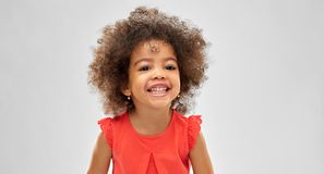 Happy little african american girl over grey royalty free stock photos