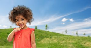 Happy little african american girl in summer royalty free stock images