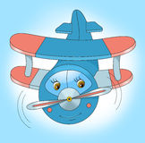 Happy little airplane flies in the sky Royalty Free Stock Image