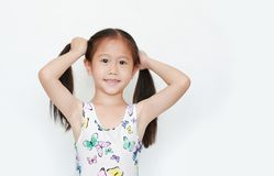 Happy of little Asian child girl holding pigtail on white background. Portrait smiling kid with two pigtails stock photo
