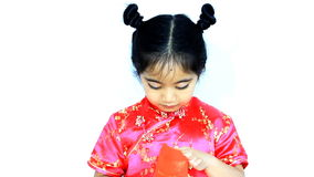 Happy little Asian Chinese child surprising with red envelop. Chinese new year