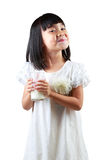 Happy little asian girl holding a cup of milk Stock Photos
